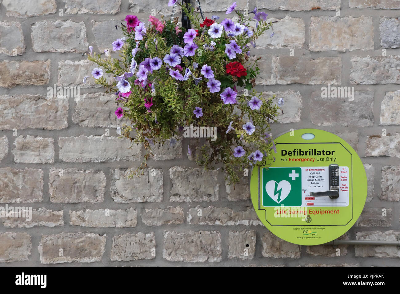 Defibrillator on the outside wall of the Black Lion Pub in Firbeck Village near Worksop Stock Photo