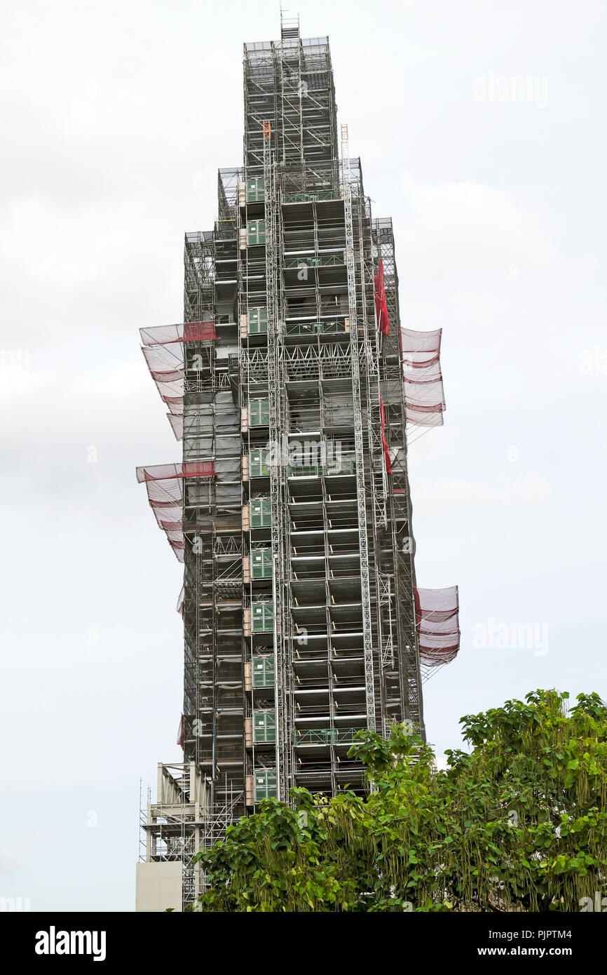 View of Big Ben clock tower at the Houses of Parliament with scaffolding, safety nets and elevator during refurbishment in Westminster London UK - Stock Image