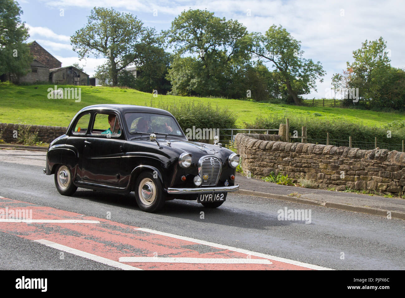 Black 1948 Austin A35 Classic, vintage, veteran, cars of yesteryear, restored collectibles at Hoghton Tower Class Cars Rally, UK - Stock Image