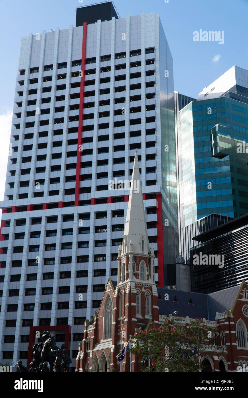 Old brick church in front of a modern high-rise in Brisbane city - Stock Image