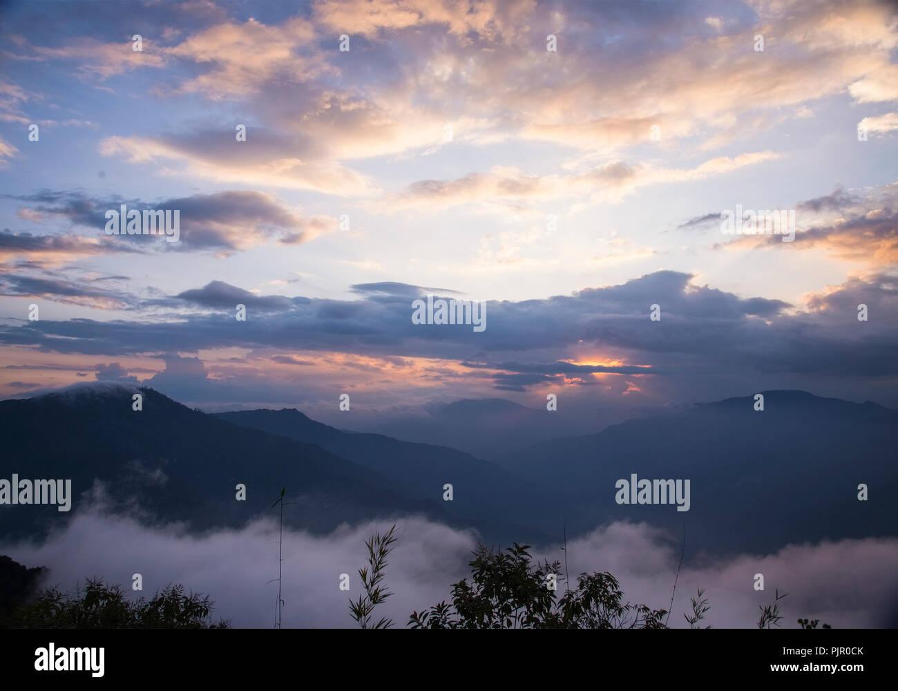 Sun set,cloulds,Rolling Himalayan Hills,Selarigaon,Silk Route,West Bengal,India. - Stock Image