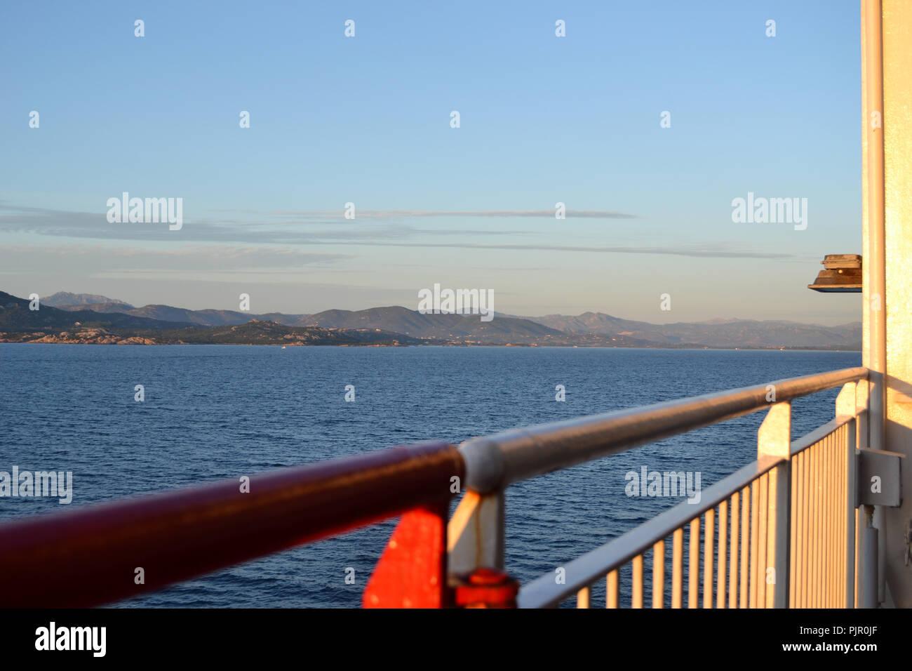 Cruise ship arriving to Olbia harbour, Sardinia island, morning scene - Stock Image
