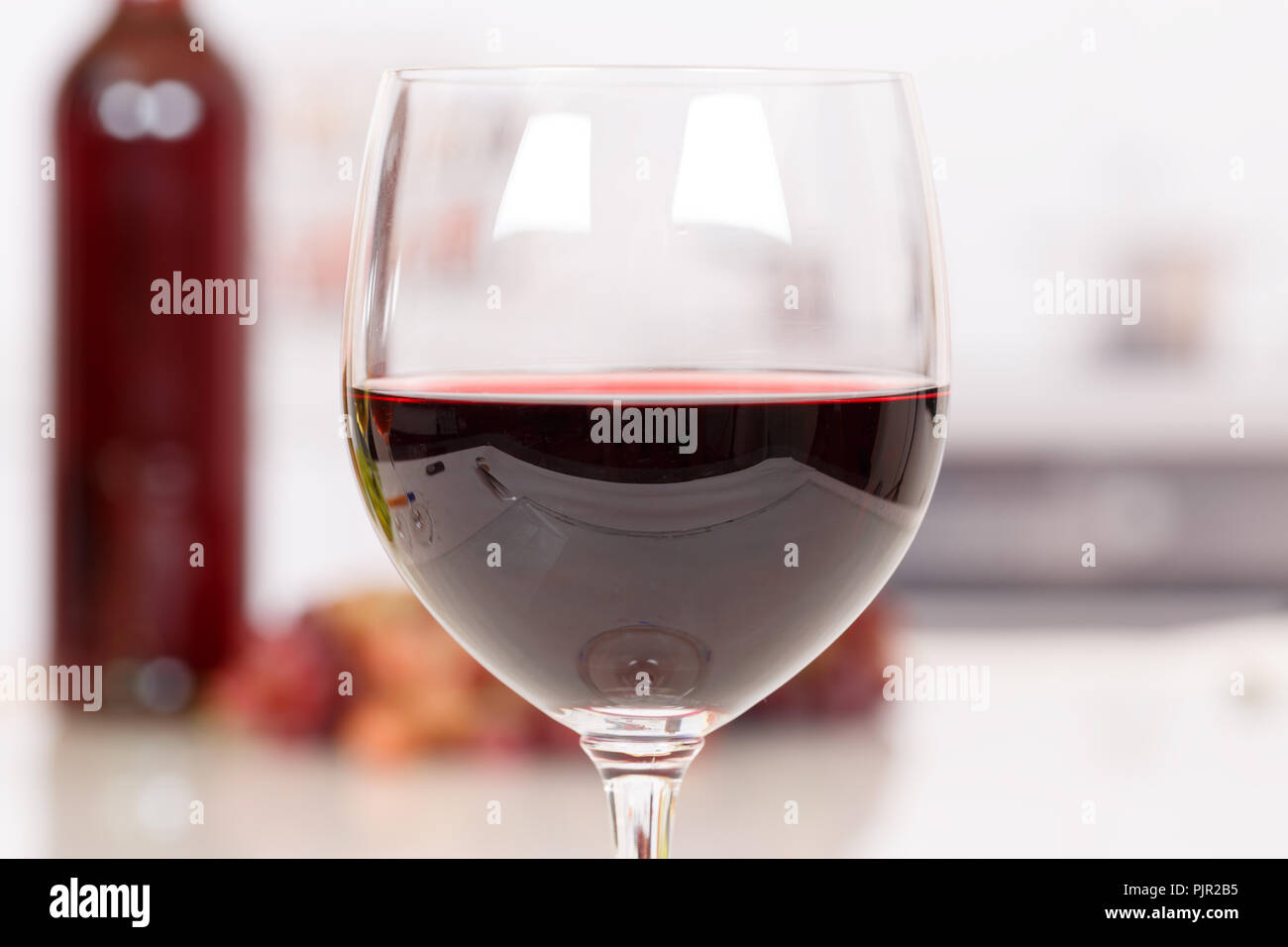 Red wine in a glass drink alcohol - Stock Image
