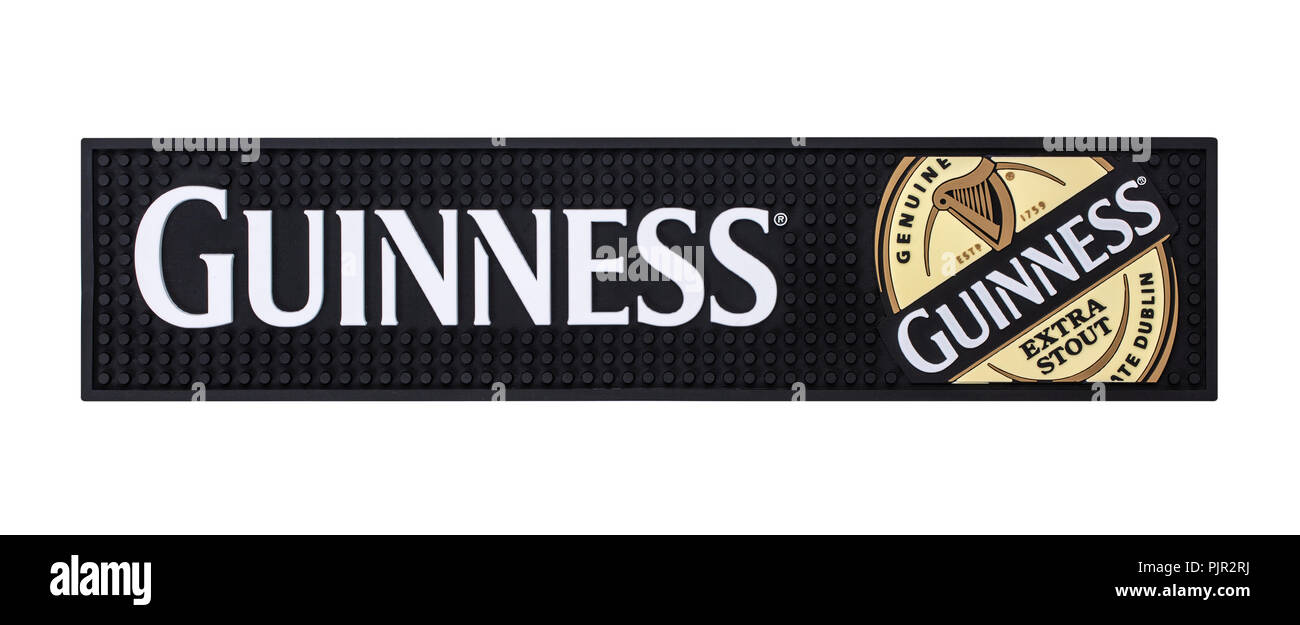 SWINDON, UK - SEPTEMBER 9, 2018: Guinness Rubber beer mat on a white background Stock Photo