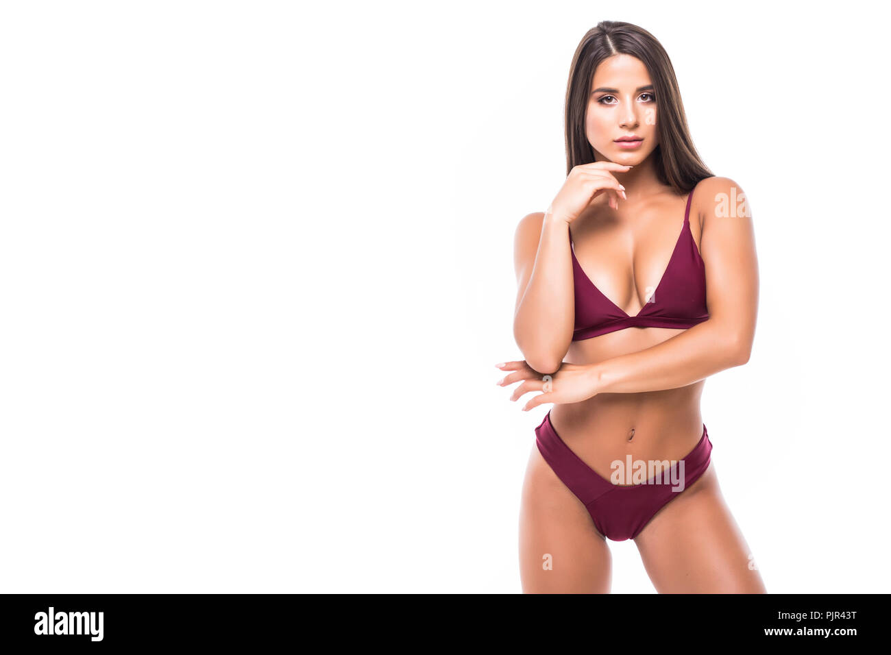 210d61bceb06c Young woman with slim perfect body in bikini isolated white background