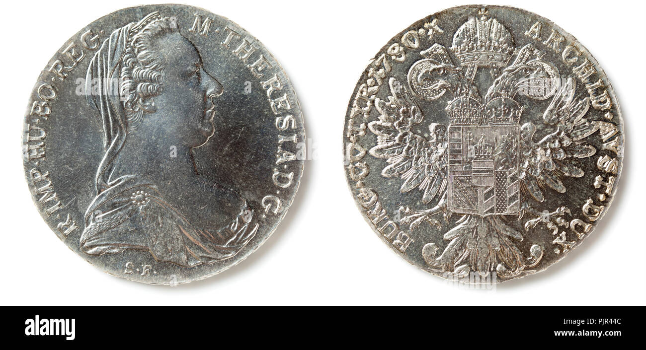 Front and back of a Maria Theresa Thaler (Maria Theresia Taler) coin, isolated on white. The coin is made since 1741 mostly in Austria. - Stock Image