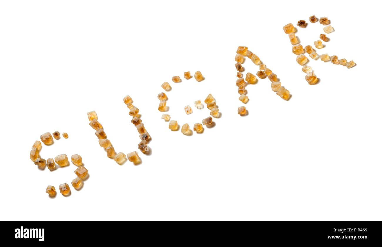 The word SUGAR spelled with brown sugar crystals isolated on white. - Stock Image