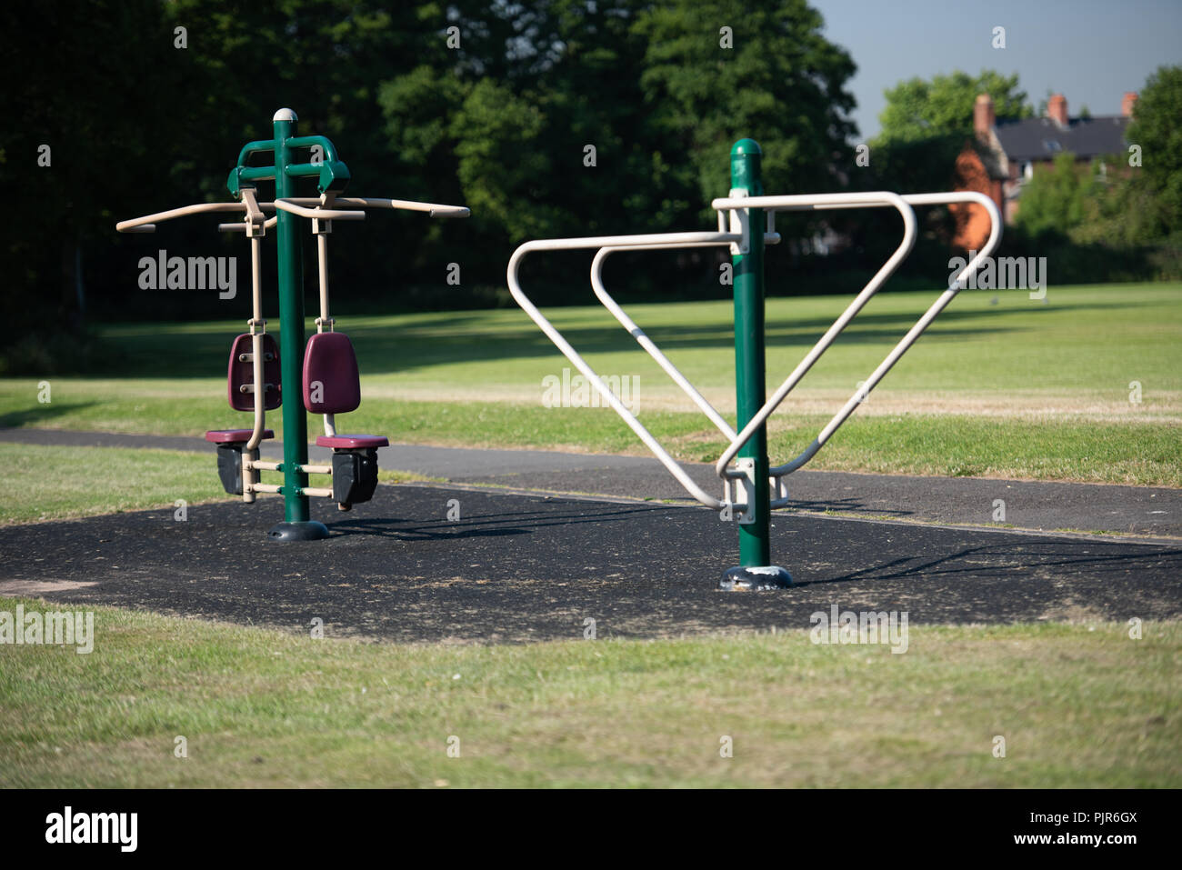 Outdoor gym exercise equipment in a public park. - Stock Image