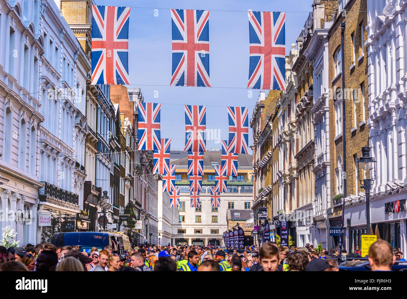 Many Union Flags Union Jacks flying above a street in London. - Stock Image