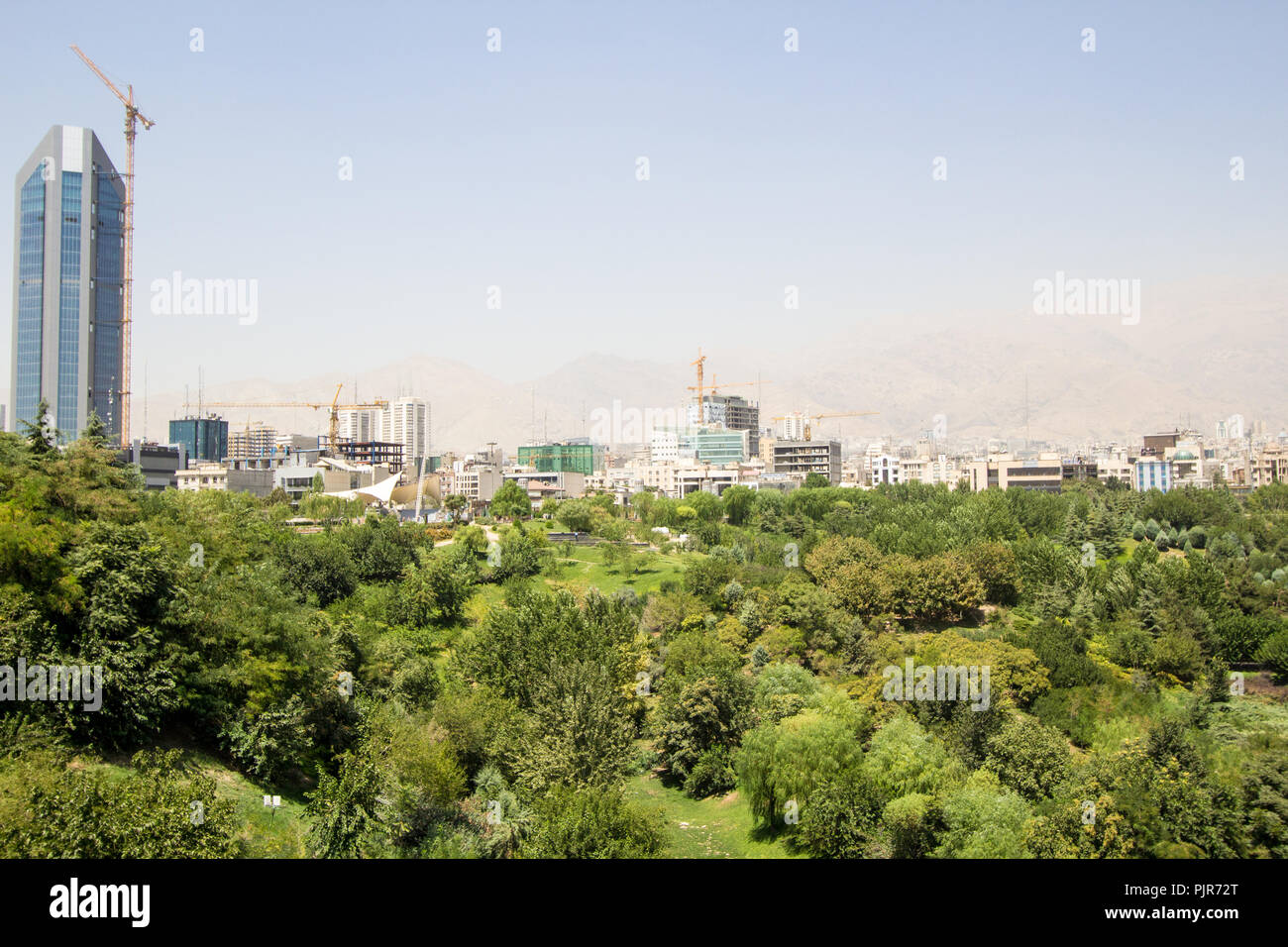 Ariel photo for Tehran city in Islamic Republic of Iran, which show Streets and buildings and some cars and some trees. - Stock Image