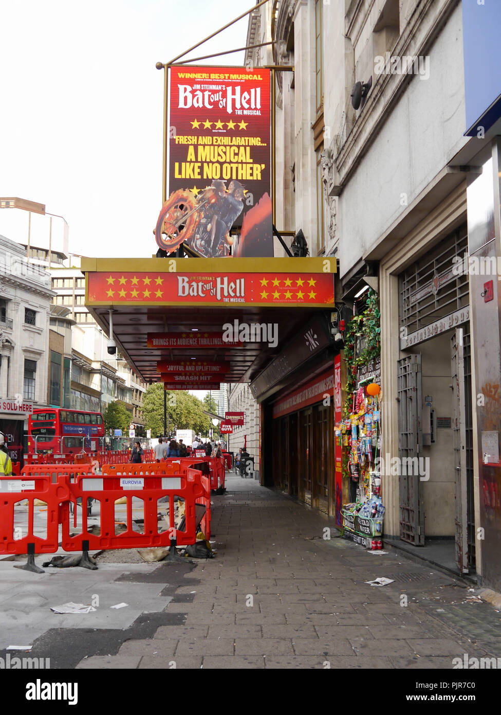 The Dominion theatre in London, advertising the musical 'Bat out of hell' - Stock Image