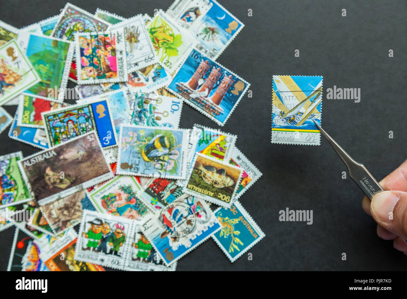 Assortment of international used stamps - Stock Image