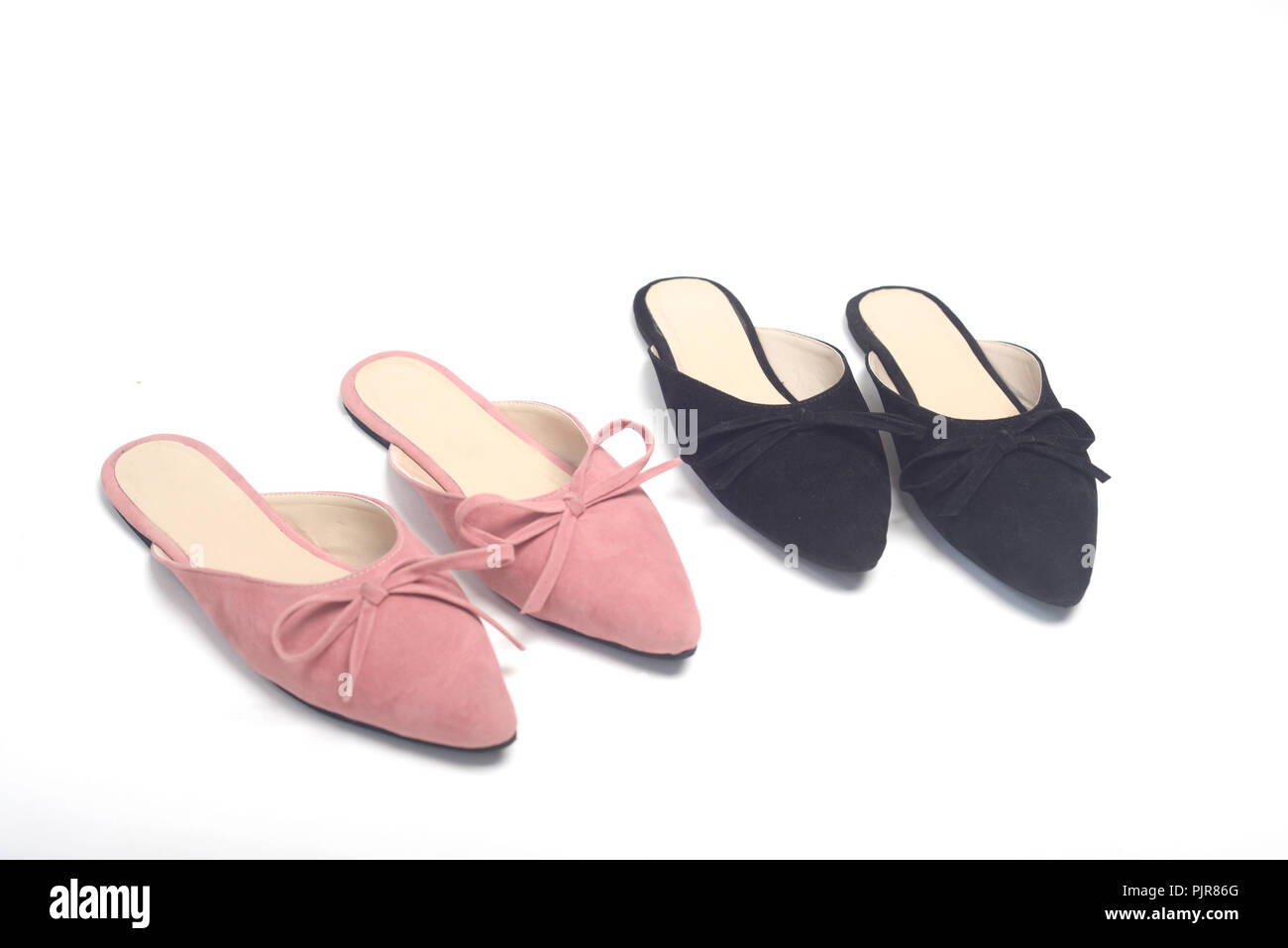 Girl shoes on white background - Stock Image