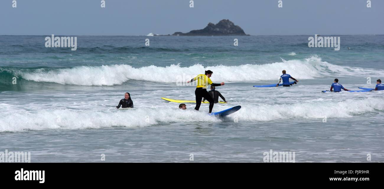People from a surfing school practising in Sennen Cove,Cornwall,England,UK - Stock Image