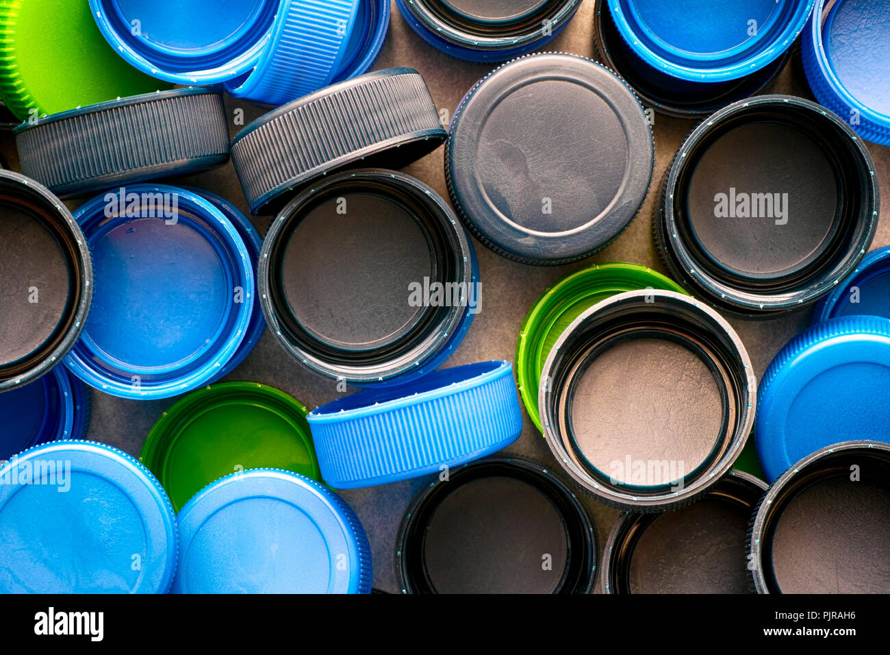 Plastic caps on black backgrounds. Close-up. - Stock Image