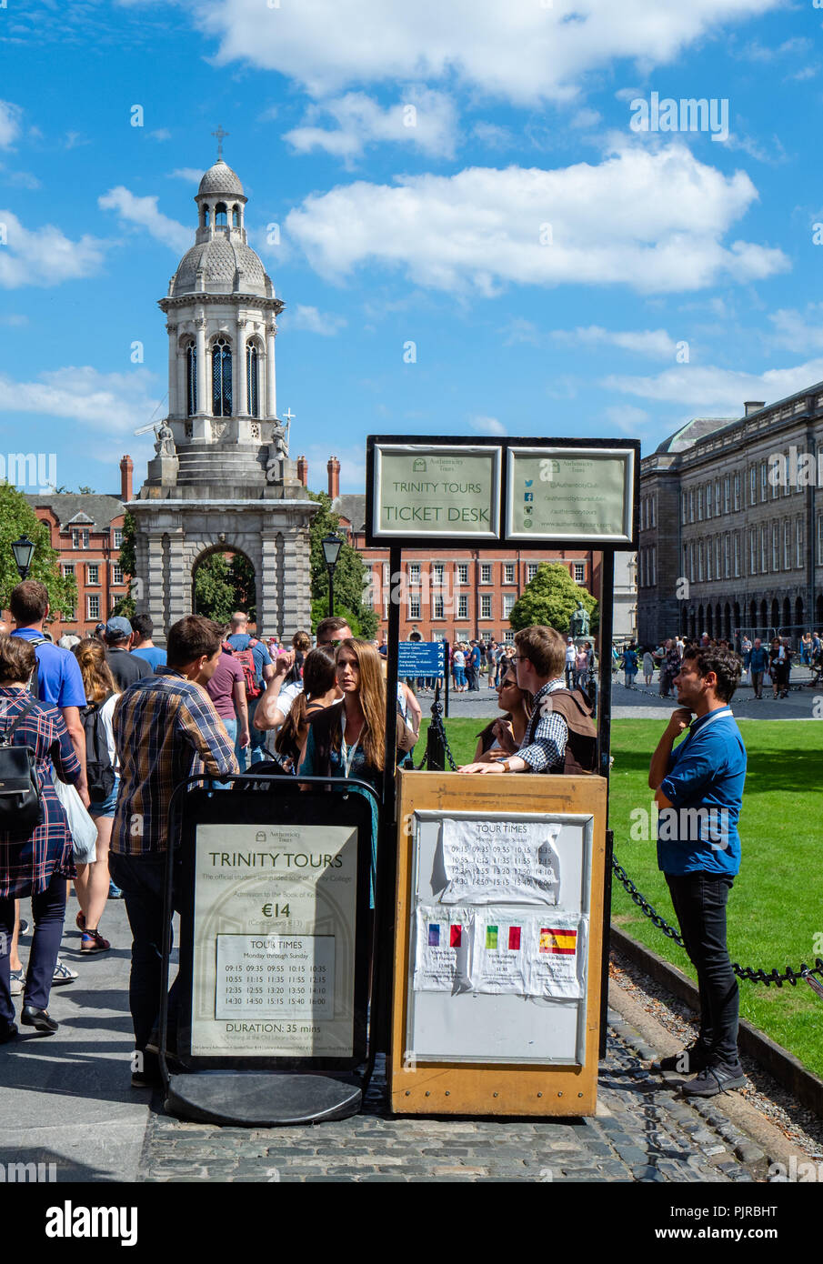 Students at Trinity College Dublin welcoming visitors and offering tours of the university - Stock Image