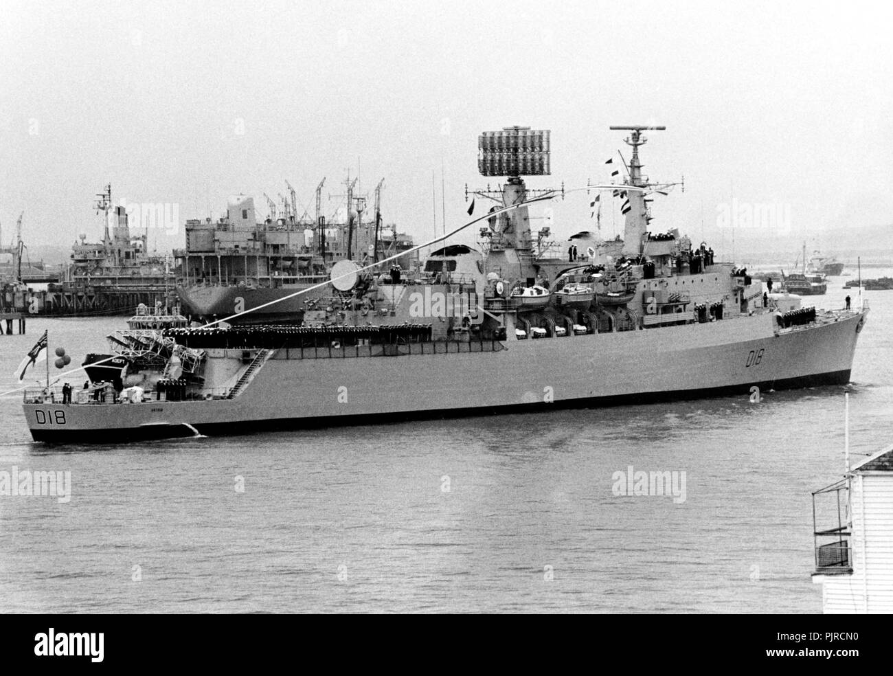 AJAXNETPHOTO. 18TH APRIL, 1984. (PMO1). PORTSMOUTH, ENGLAND. PAYING OFF - THE DESTROYER HMS ANTRIM STREAMS HER PAYING OFF PENDANT AS SHE ENTERS HARBOUR FOR THE LAST TIME AS A SHIP OF HER MAJESTY'S ROYAL NAVY.VESSEL RECEIVED DIRECT BOMB HOT DURING FALKLAND ISLANDS CONFLICT. PAID OFF SUBJECT TO SALE TO CHILEAN NAVY.