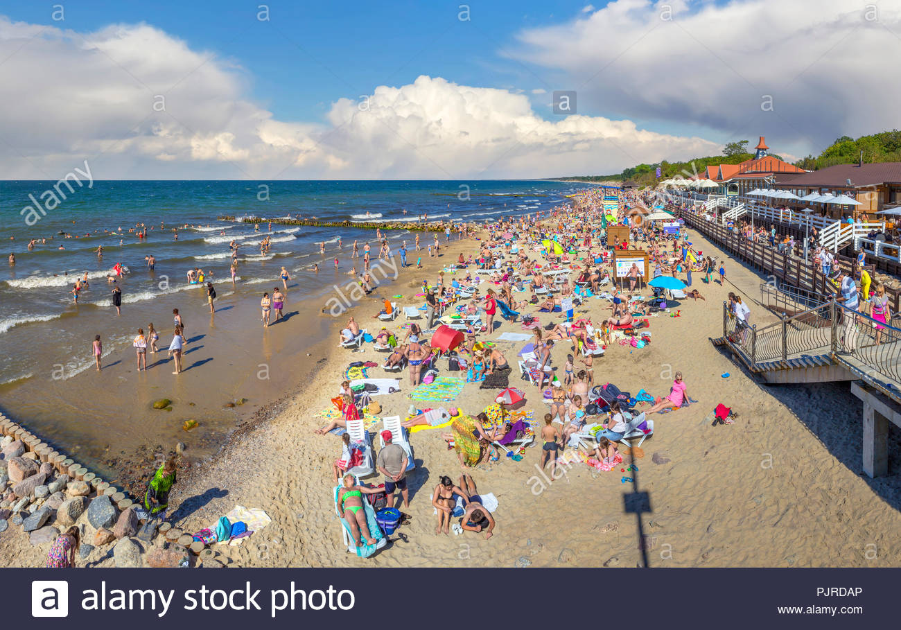 Zelenogradsk, Russia - July 22, 2017: People swim and sunbathe on the city beach in the height of summer. - Stock Image