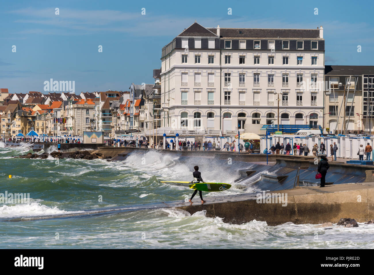 Wimereux, France - 16 June 2018: View of the sea front promenade as waves are hitting the seawall. - Stock Image