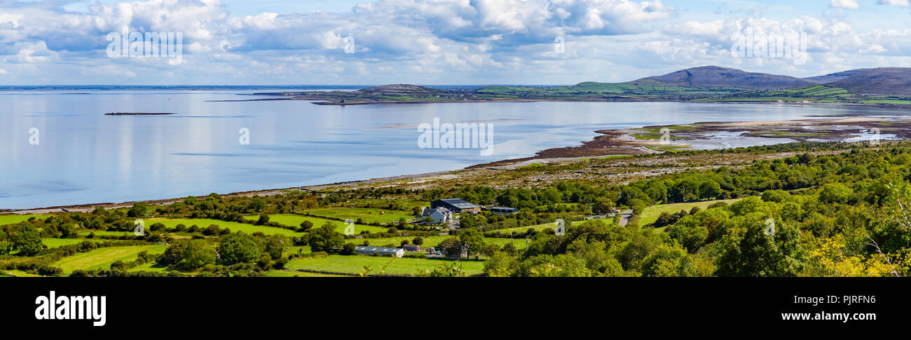 Farms and beach in Ballyvaughan bay, Clare, Ireland - Stock Image