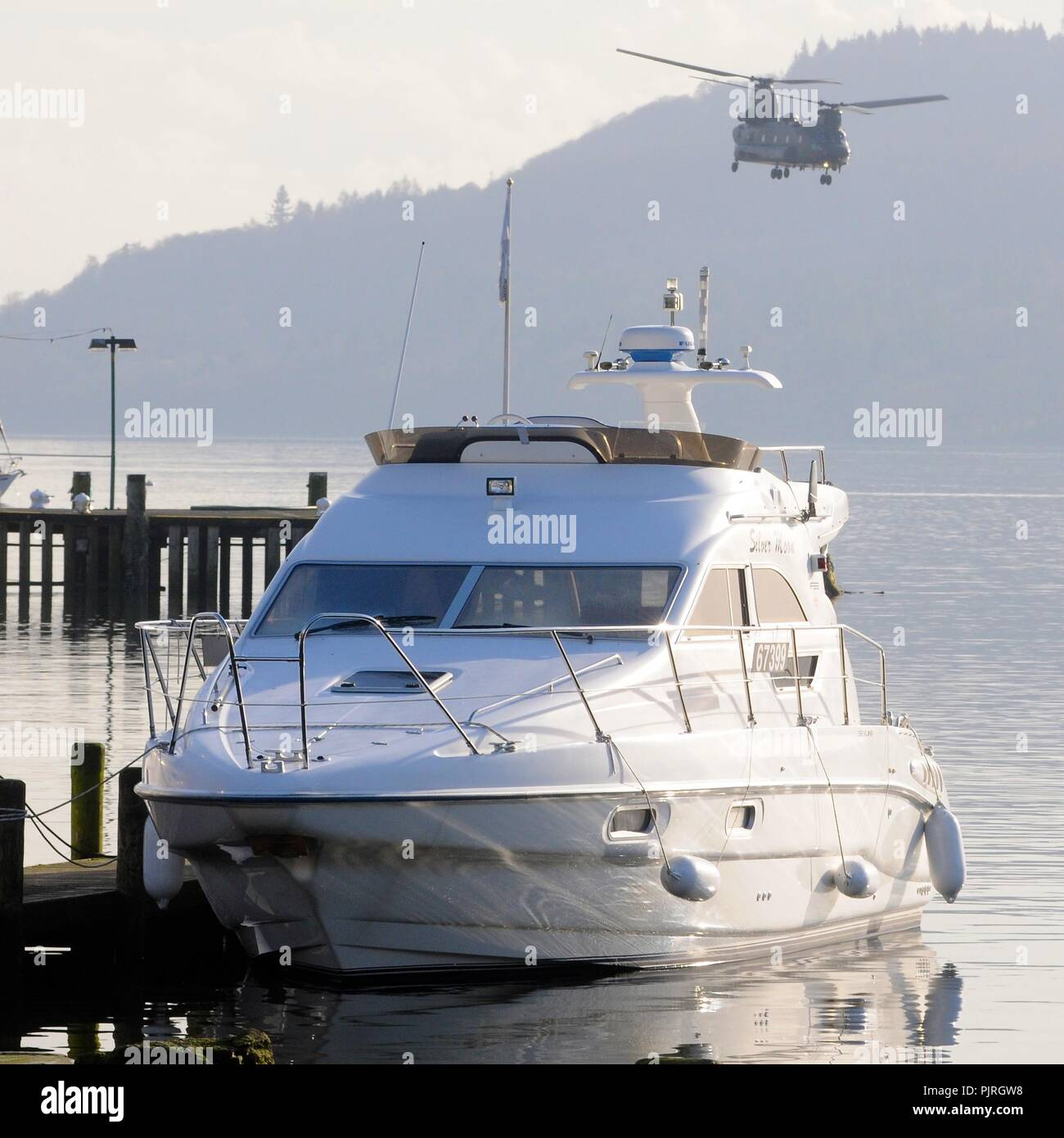 Boat and helicopter on Lake Windermere - Stock Image