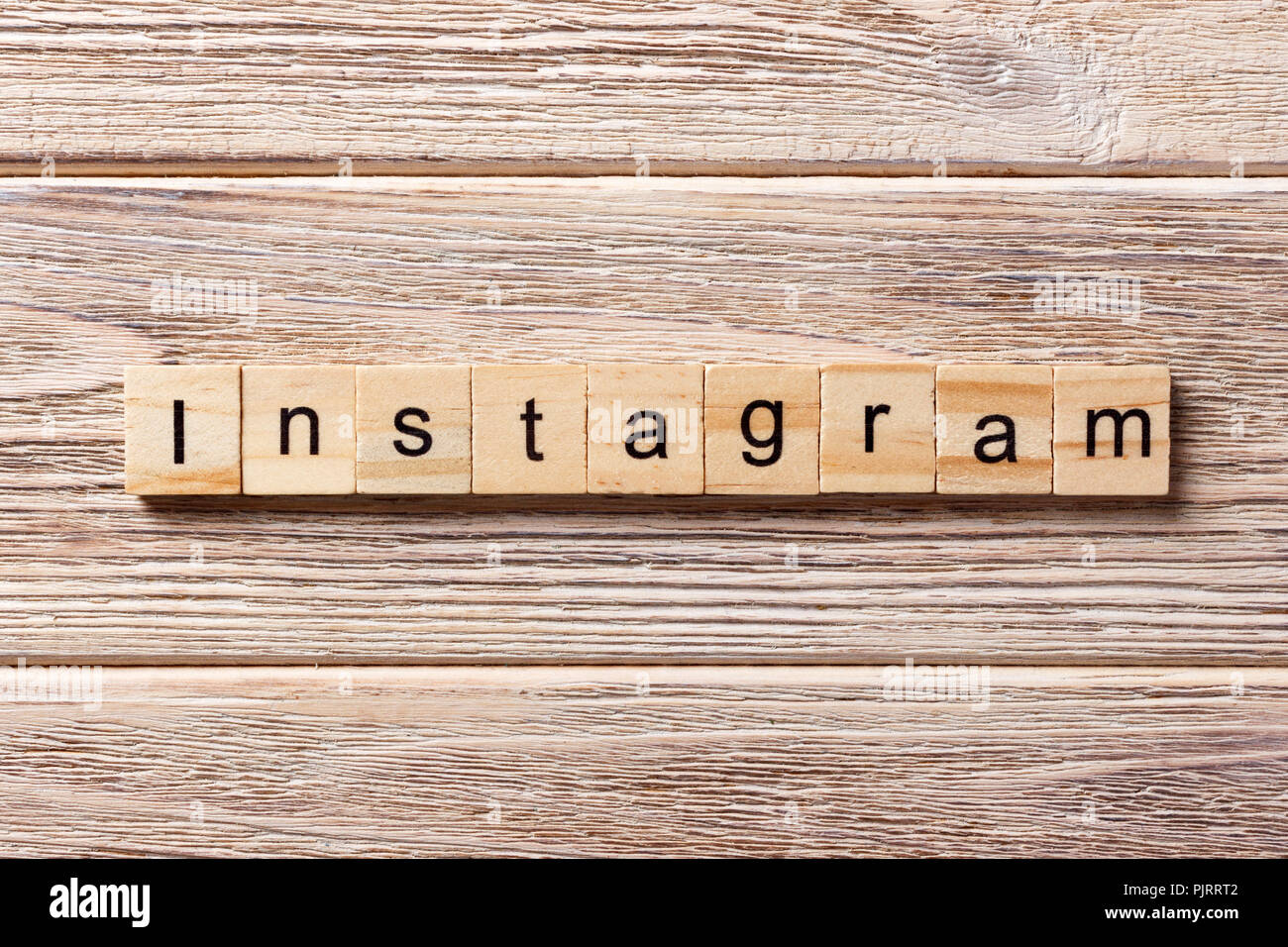 Instagram word written on wood block. Instagram text on table, concept. - Stock Image