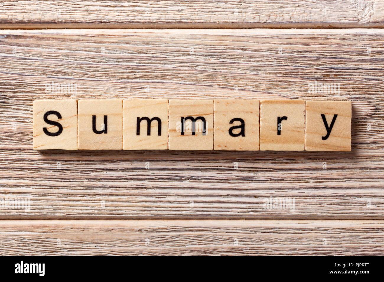 Summary word written on wood block. Summary text on table, concept. - Stock Image
