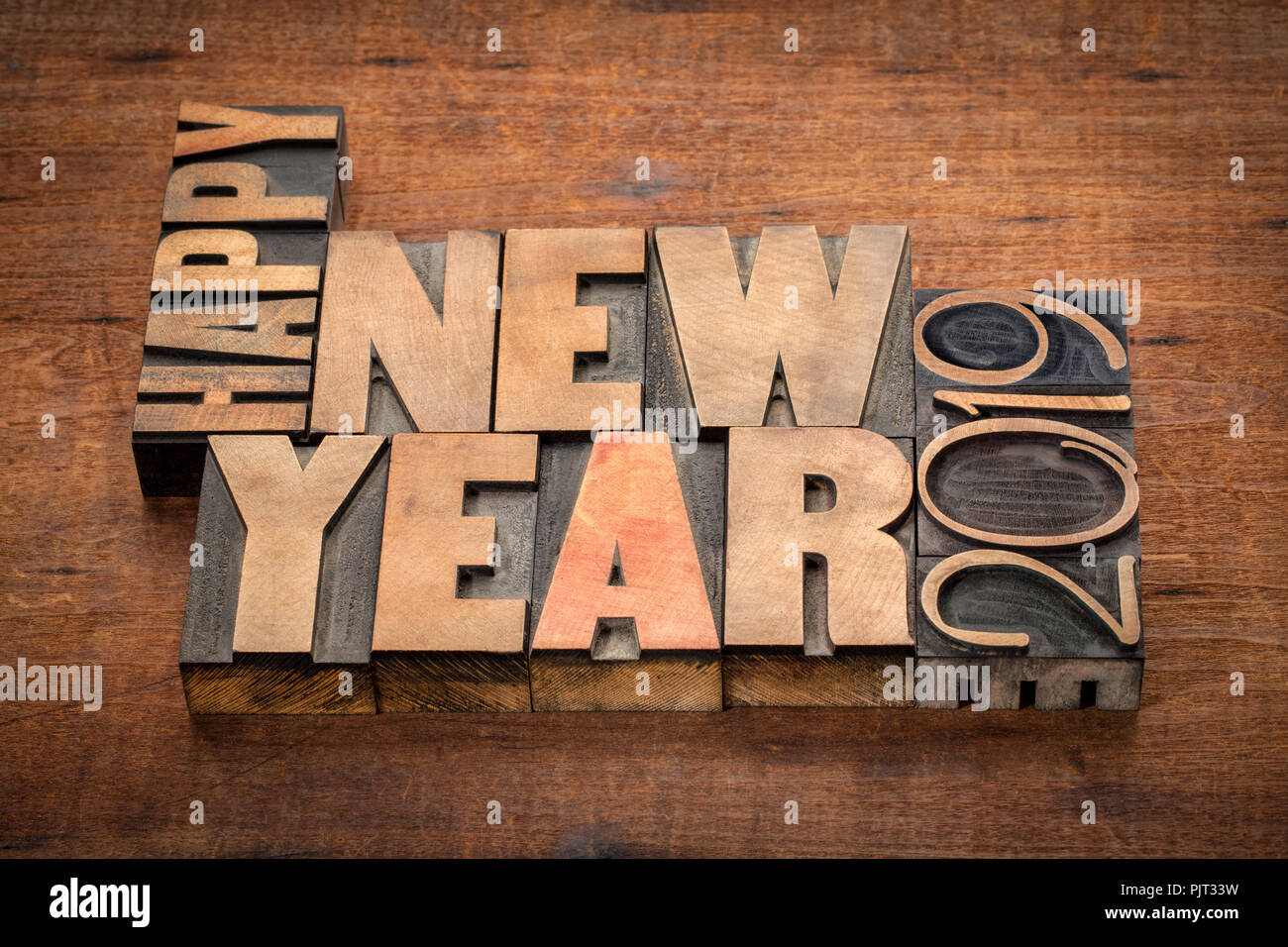 happy new year 2019 greeting card word abstract in vintage letterpress wood type blocks on a grunge wooden background