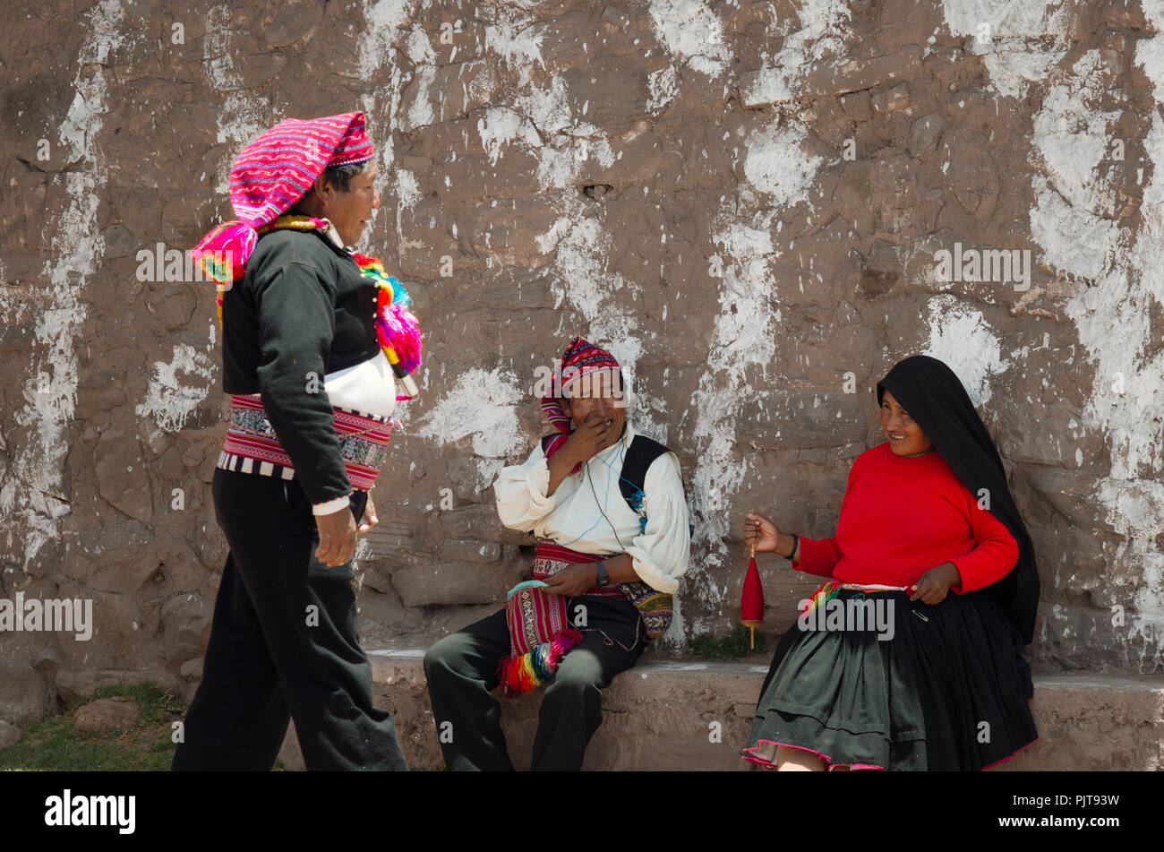 The Mayor Of Taquile island Greeting Local People. October 17, 2012 - Taquile island, Peru - Stock Image