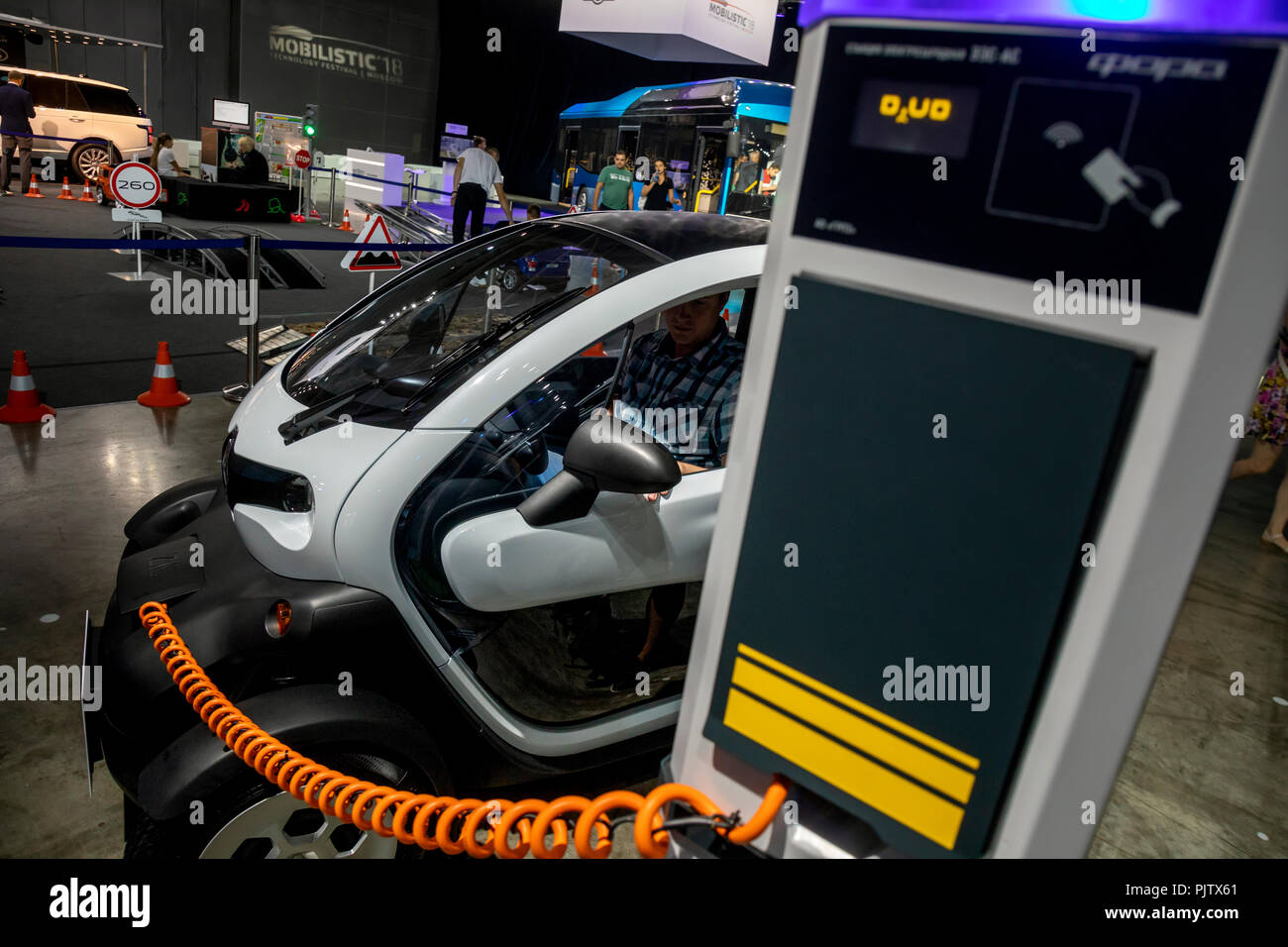 A new electric car Renault Twizy is charged from the charging station at the technology festival Mobilistic 2018 in Moscow, Russia Stock Photo