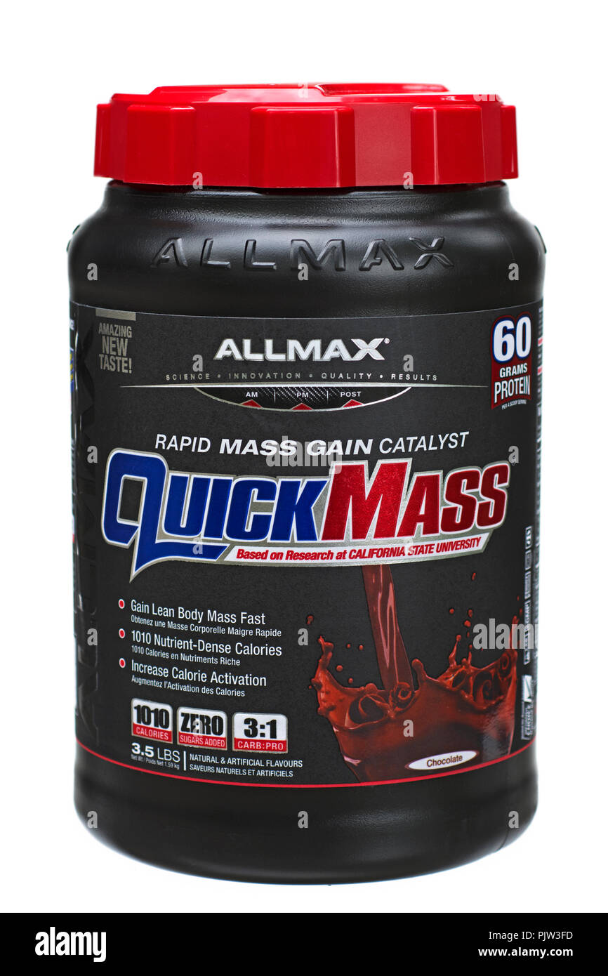 Mass Gainer Protein Powder Mix Tin, Jar of Quick Mass Powder Weight Gainer used by Athletes, Bodybuilders, Weightlifters - Stock Image