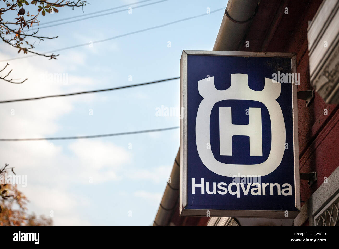 PANCEVO, SERBIA - SEPTEMBER 8, 2018: Husqvarna logo on their main shop in Pancevo. Husqvarna is a Swedish manufacturer of outdoor power products sprea - Stock Image