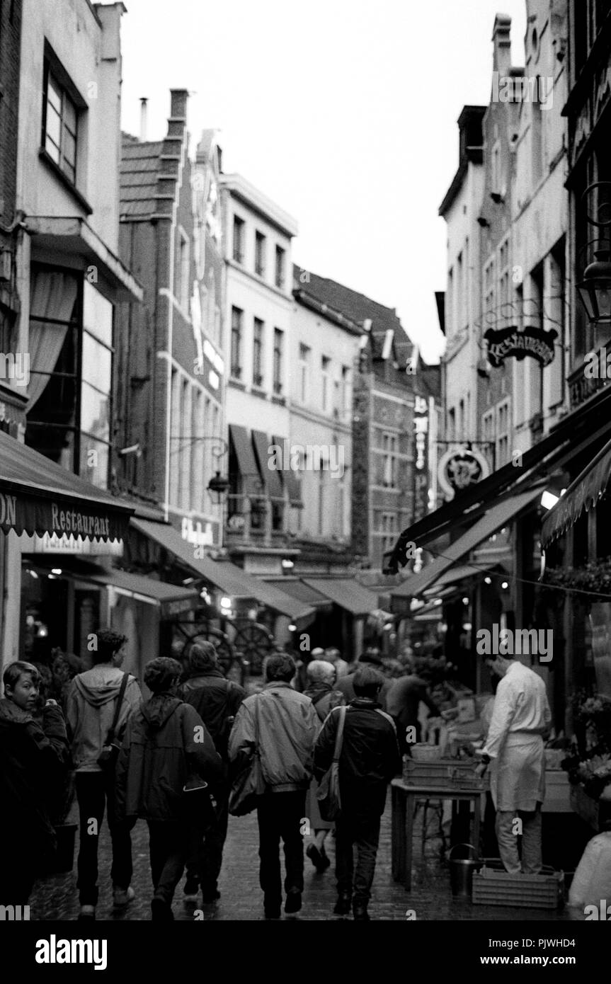 The Rue des Bouchers, street of the butchers, a gathering place for tourists with many bistros and restaurants in Brussels (Belgium, 1993) - Stock Image