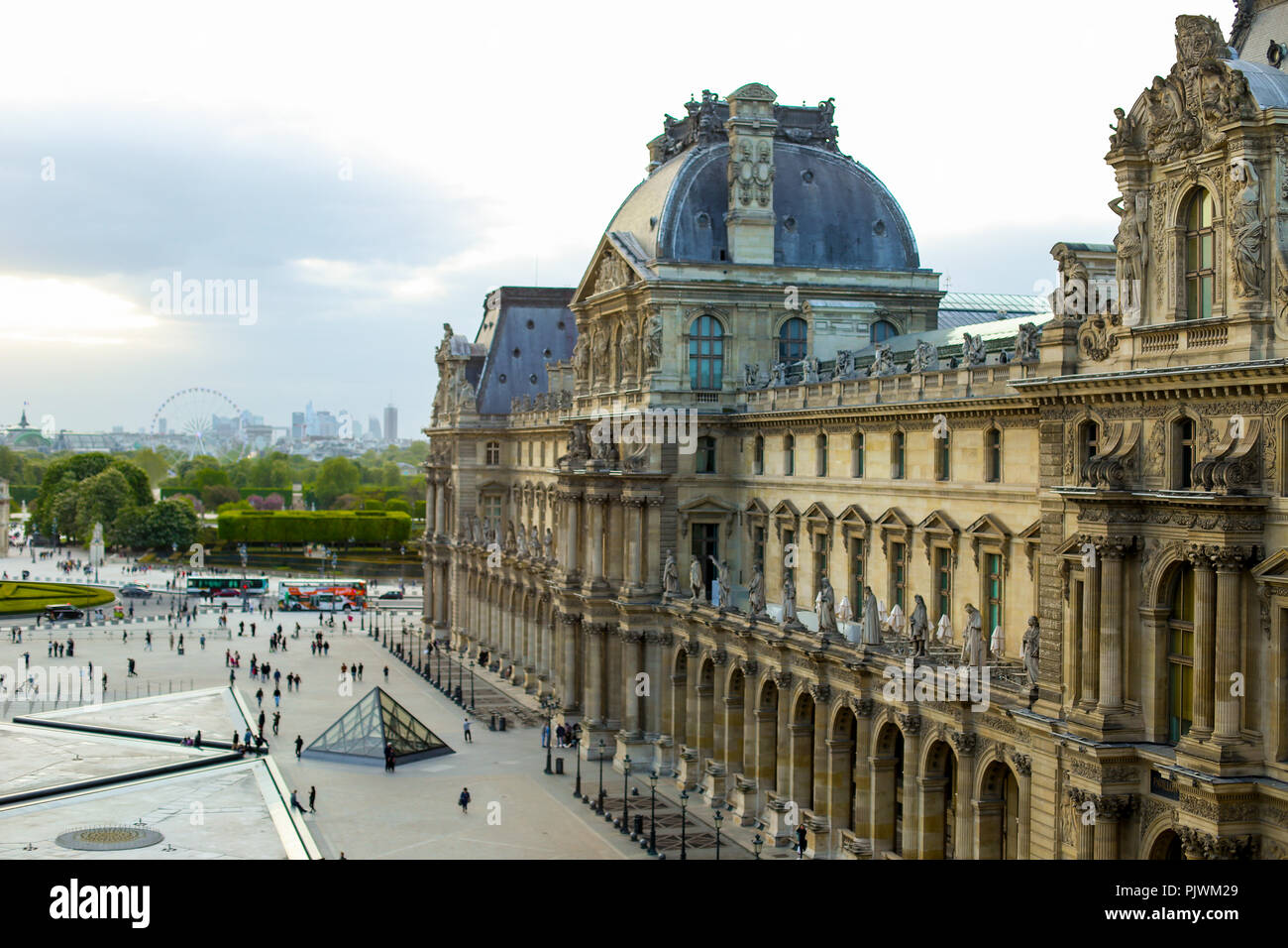 Tourists walking near Louvre in Paris, France. - Stock Image