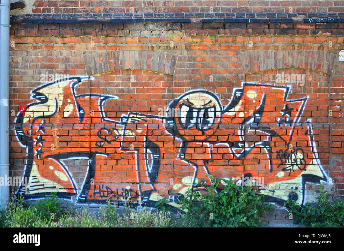 Fragment Of An Old Colored Graffiti Drawing On The Wall Background