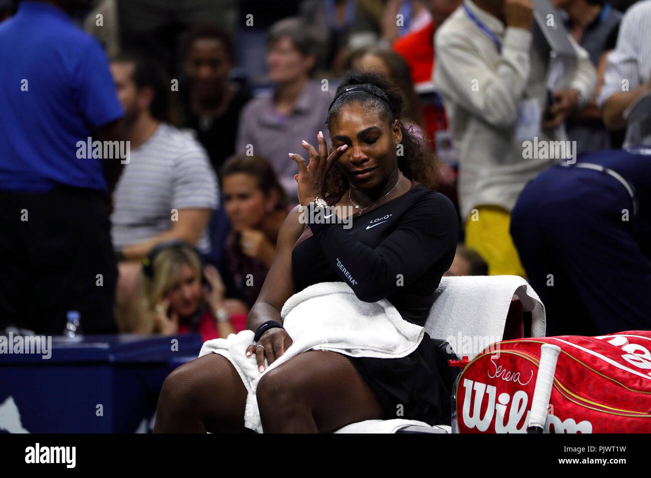 New York, USA. 8th September 2018.  US Open Tennis:   Serena Williams wipes a tear moments after her loss to Naomi Osaka of Japan in the US Open women's final.   Williams was penalized a game at 4-3 in the final set, which added controversy to the match. Credit: Adam Stoltman/Alamy Live News - Stock Image