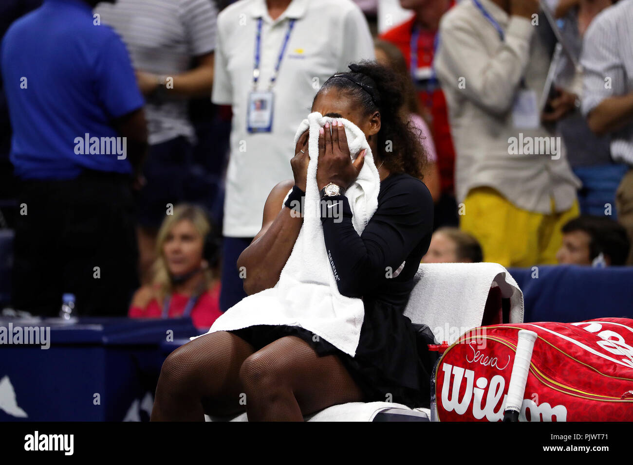 New York, USA. 8th September 2018.  US Open Tennis:   Serena Williams tries to consoles herself moments after her loss to Naomi Osaka of Japan in the US Open women's final.   Williams was penalized a game at 4-3 in the final set, which added controversy to the match. Credit: Adam Stoltman/Alamy Live News - Stock Image