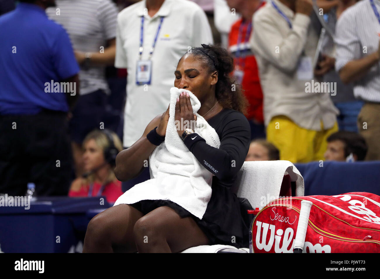 New York, USA. 8th September 2018.  US Open Tennis:   Serena Williams tries to compose herself moments after her loss to Naomi Osaka of Japan in the US Open women's final.   Williams was penalized a game at 4-3 in the final set, which added controversy to the match. Credit: Adam Stoltman/Alamy Live News - Stock Image