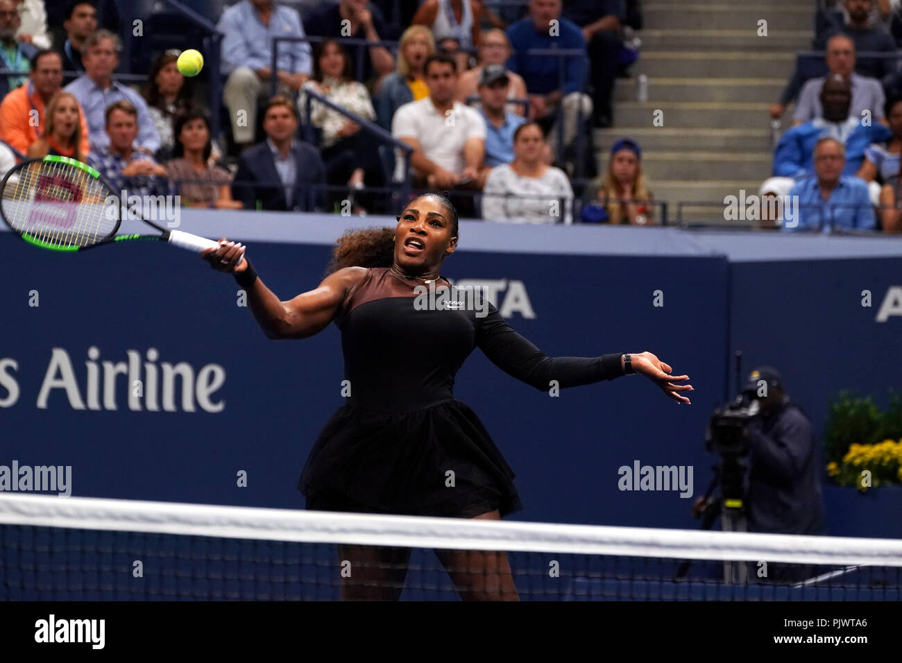 New York, USA. 8th September 2018.  US Open Tennis:  Serena Williams punches a forehand volley for a winner during her loss to Naomi Osaka of Japan in the US Open women's final. Williams was penalized a game at 4-3 in the final set, which added controversy to the match. Credit: Adam Stoltman/Alamy Live News - Stock Image