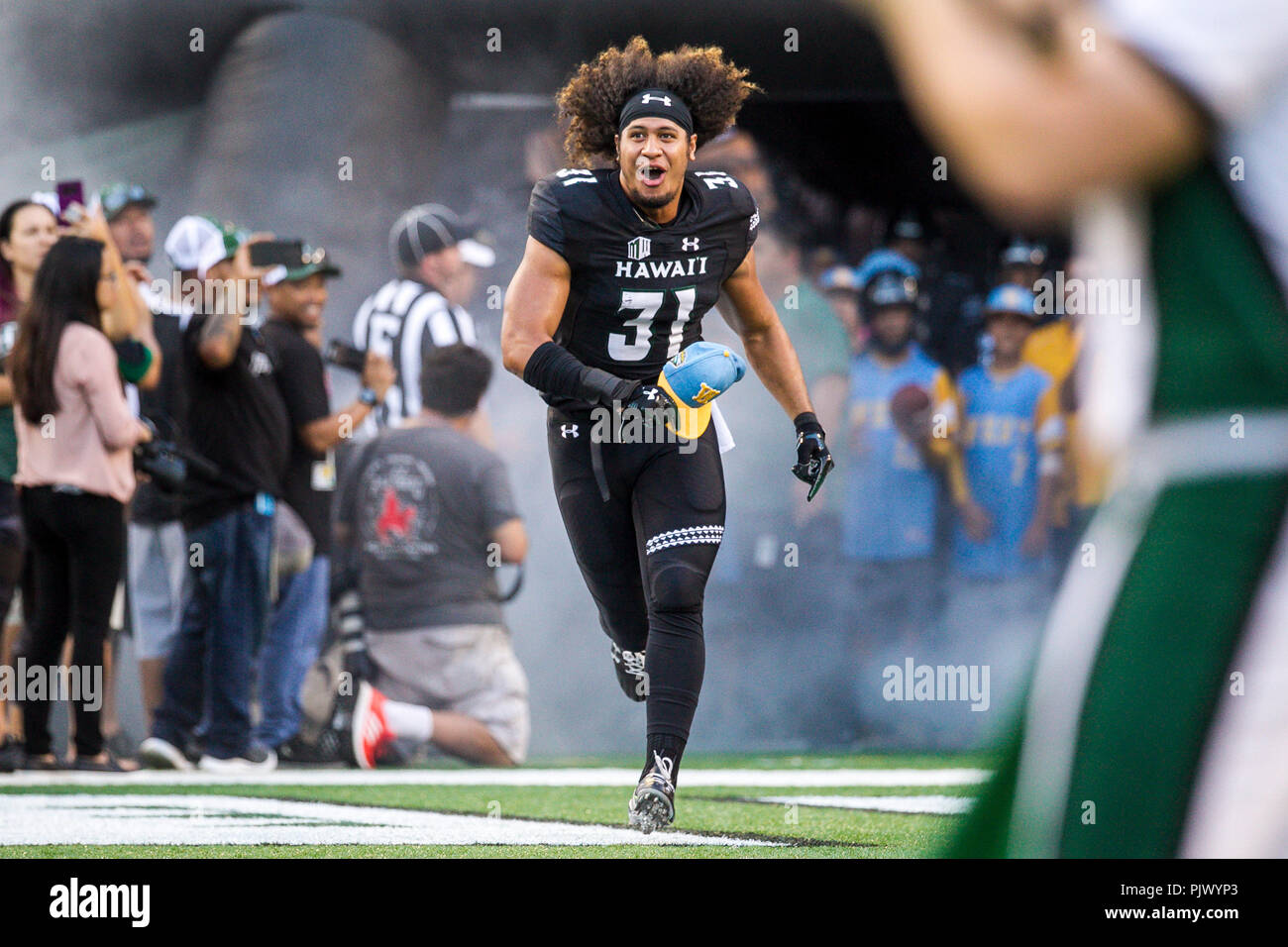 Honolulu, Hawaii. September 8, 2018 - Hawaii Rainbow Warriors linebacker Jahlani Tavai #31 is introduced before the NCAA football game between the Rice Owls and the University of Hawaii Warriors at Aloha Stadium in Honolulu, Hawaii. Glenn Yoza/CSM Credit: Cal Sport Media/Alamy Live News Stock Photo