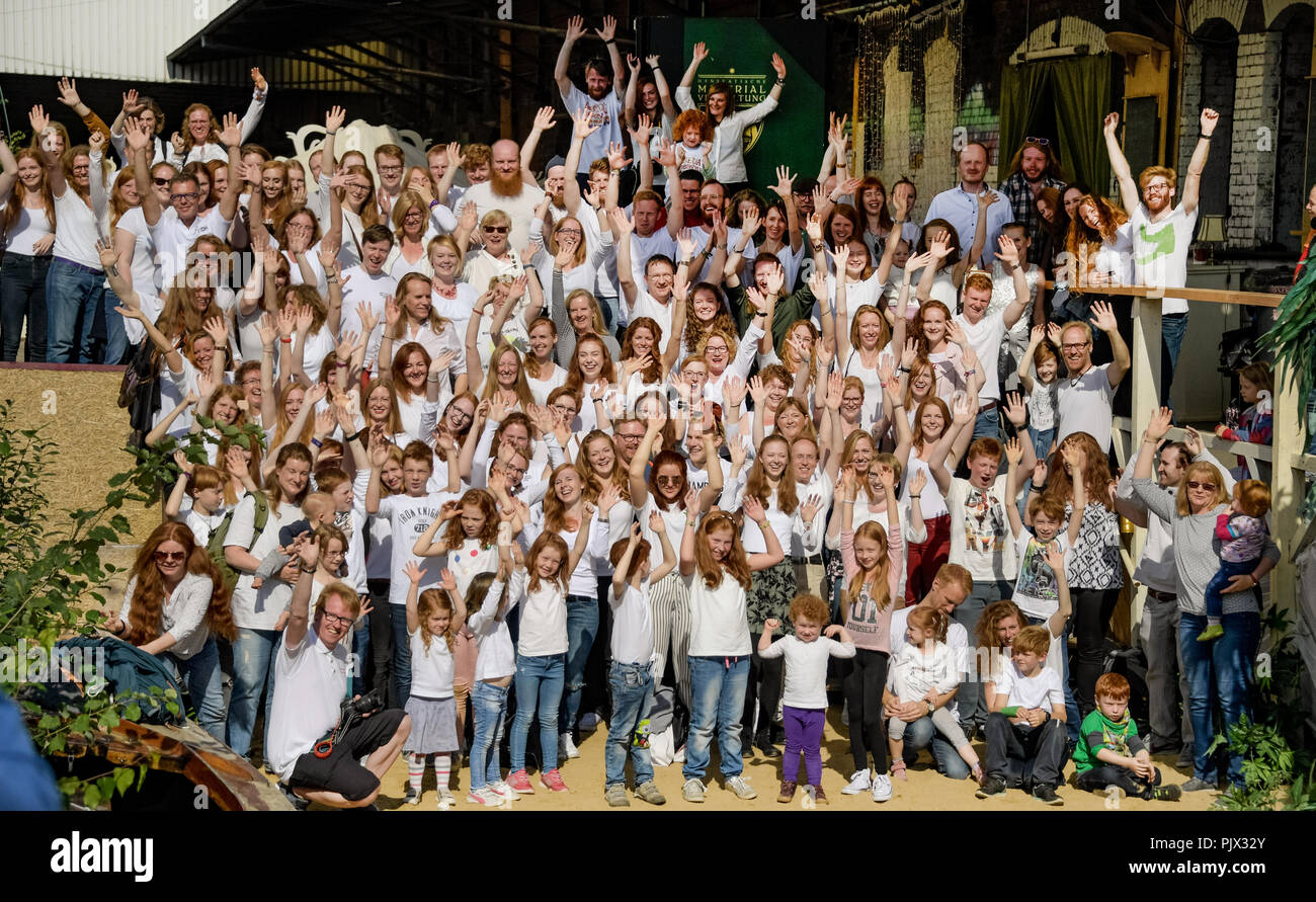 Hamburg, Germany. 09th Sep, 2018. 09.09.2018, Hamburg: The participants of the meeting of redheaded people from all over Germany wave to the photographer's camera for a final picture in the upper harbour. About 150 million people in the world have red hair. Natural red hair is rare, at most two percent of the world's population are real Redheads. The meeting of redheaded people from all over Germany is organized by the editor of the 'Magazine for redheads'. Credit: Axel Heimken/dpa/Alamy Live News - Stock Image