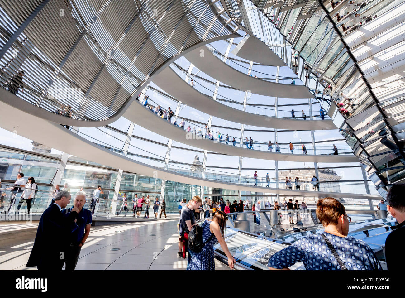 Berlin, Germany. 09th Sep, 2018. 09.09.2018, Berlin: Visitors walk through the dome of the Reichstag at the 'Day of Insights and Views' of the German Bundestag. Credit: Christoph Soeder/dpa/Alamy Live News - Stock Image