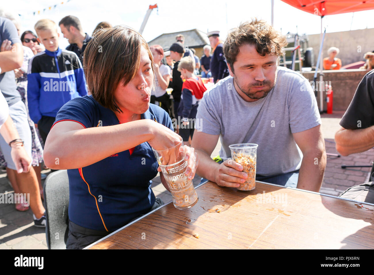 Essex, UK. 9th September 2018. Competitors take part in the 'eat a pint of cockles' competition.  The Regatta is organised by Lions Club of Leigh-on-Sea with help  from the local Sea Scouts. The event features a variety of live music, traditional food and drink. Penelope Barritt/Alamy Live News - Stock Image
