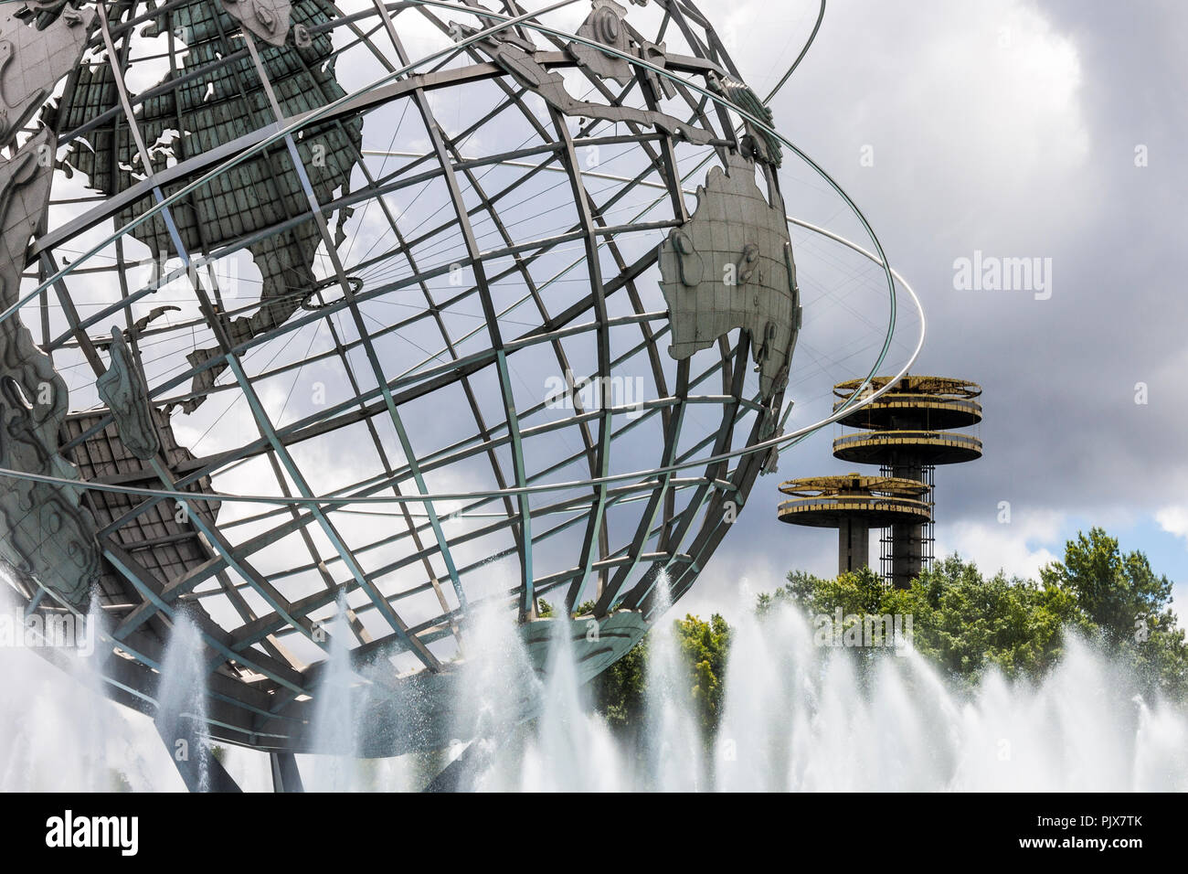 New York City. The Unisphere, a spherical stainless steel representation of the Earth in Flushing Meadows Corona Park, Queens, with the observatory to - Stock Image