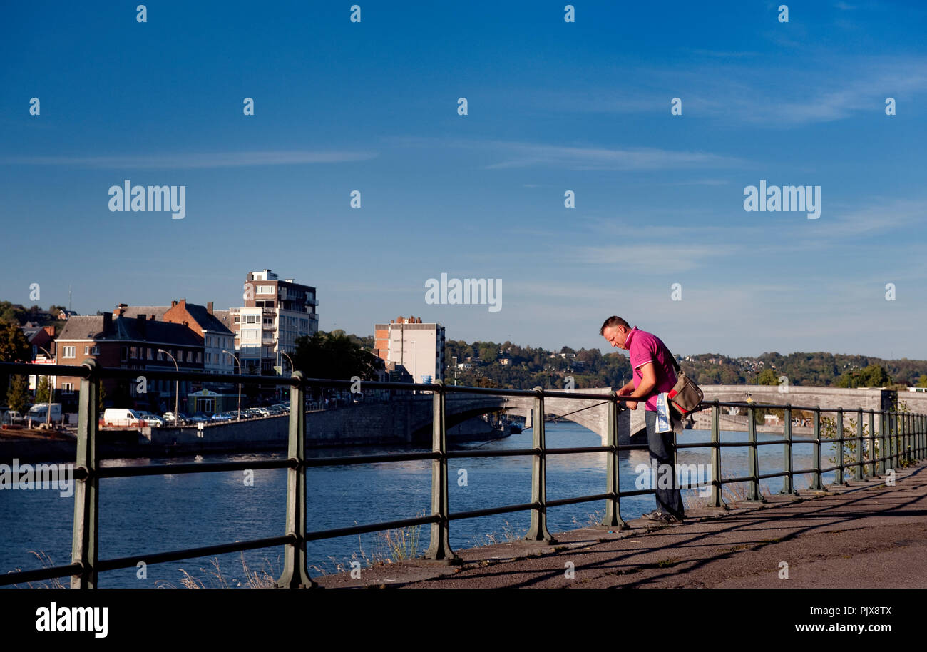 A man fishing along the Meuse river in Huy (Belgium, 29/09/2011) Stock Photo