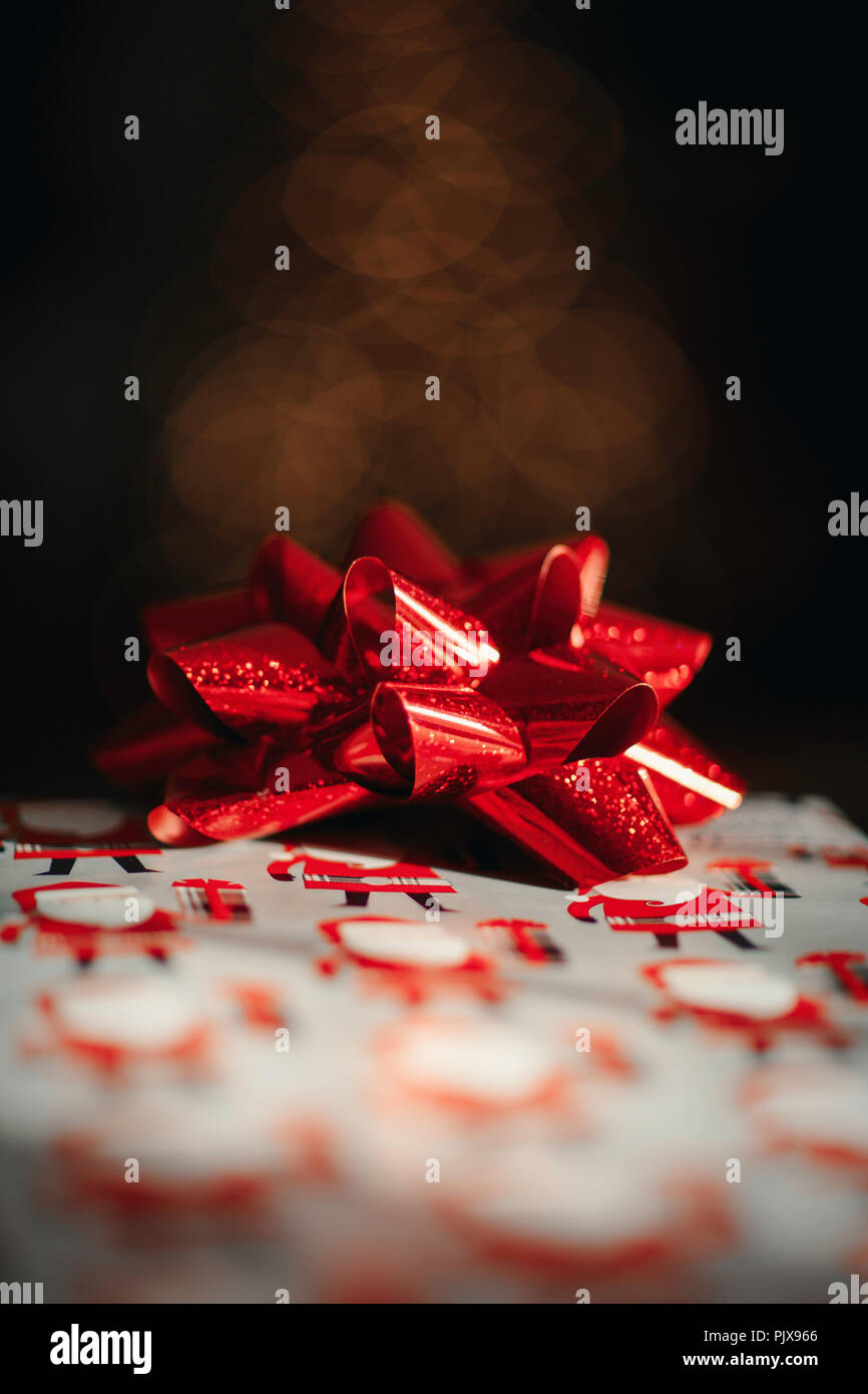 Christmas present with red bow - Stock Image