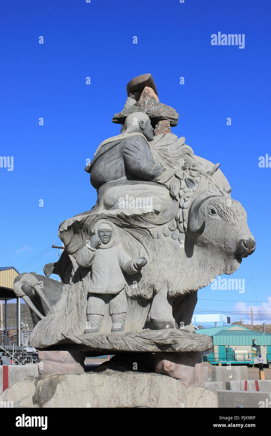 Stone carving Showing Inuit and Arctic Animals, Iqaluit, Baffin Island - Stock Image