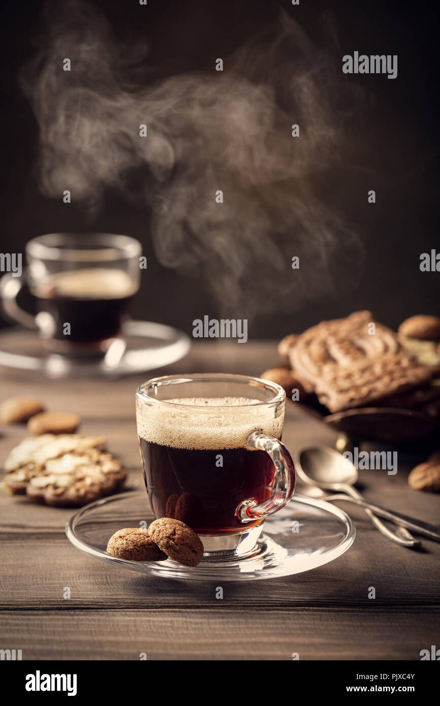 Steaming coffee cup - Stock Image