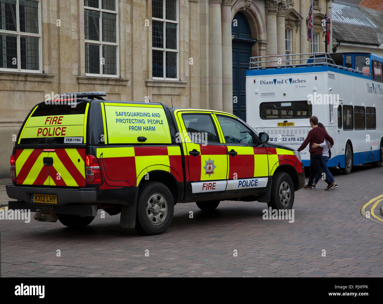 Combined Fire/Police vehicle driving down a street in Northampton,UK - Stock Image