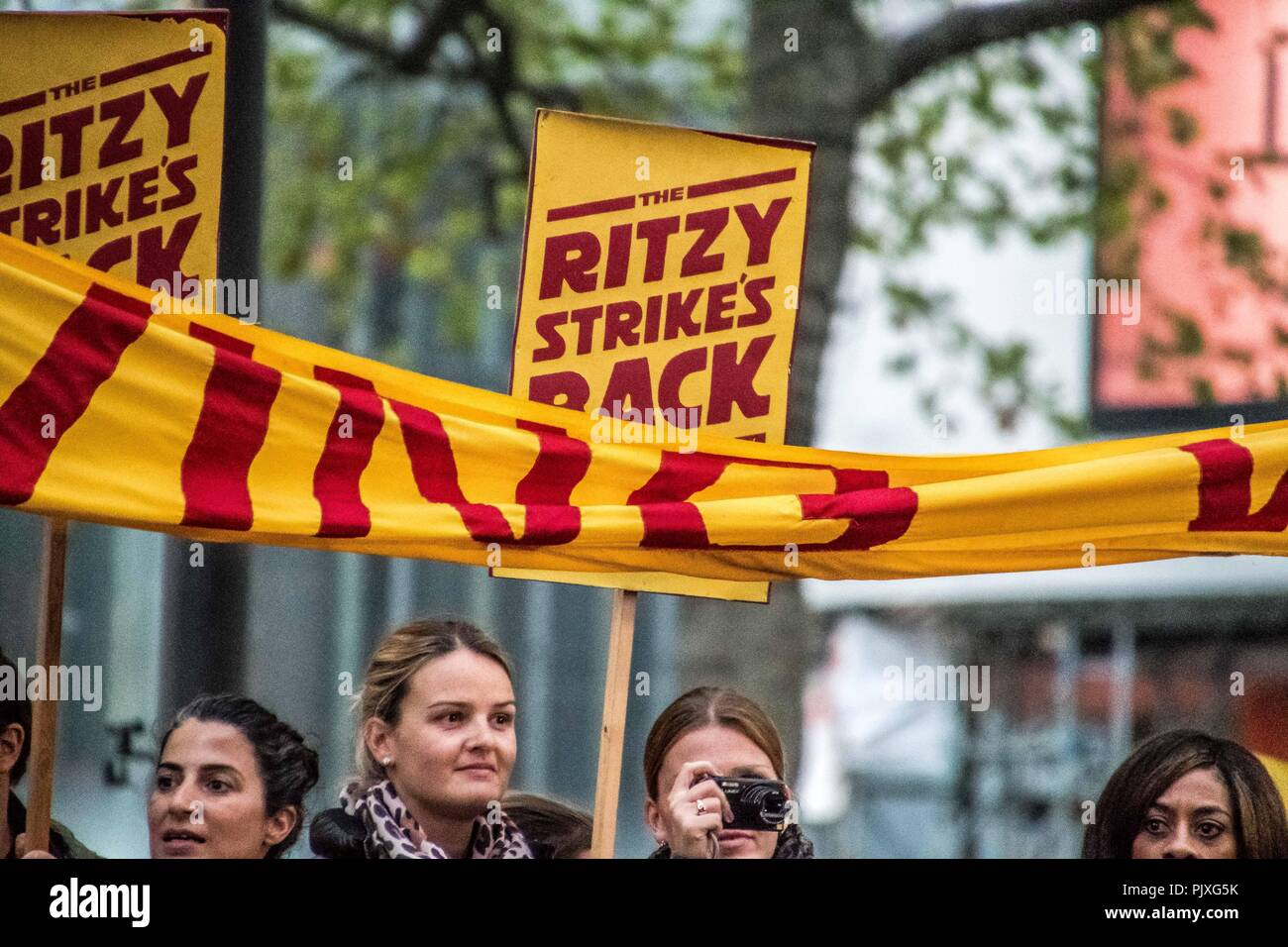 Ritzy Cinema workers disrupted the red carpet screening of the film 'La La Land' at the Odeon Theatre at Leichester Square during the BFI London Film Festival. Carrying banners declaring 'the Ritzy strikes back' in their fight for the London Living Wage (LLW) - Stock Image
